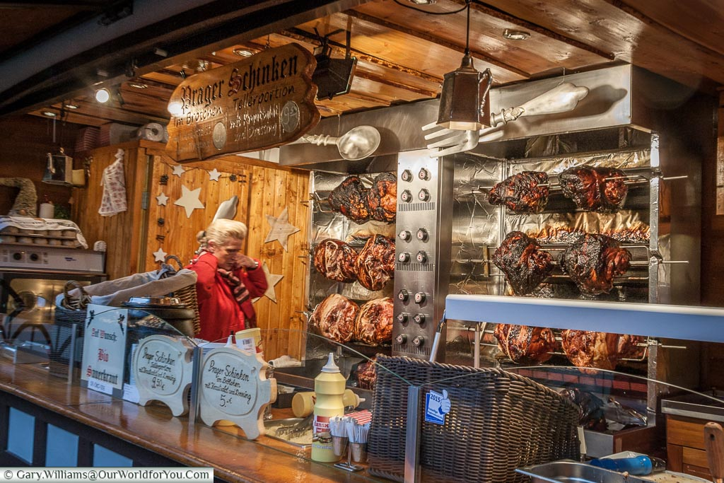 Pork joints roasting on a Christmas market stall in Cologne