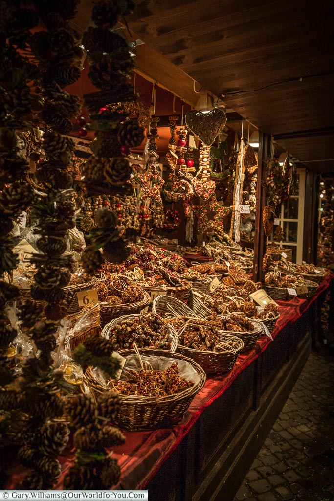 Baskets full of hand made spiced pomander balls on a stall at Colognes Altstadt market or the market of the elves.