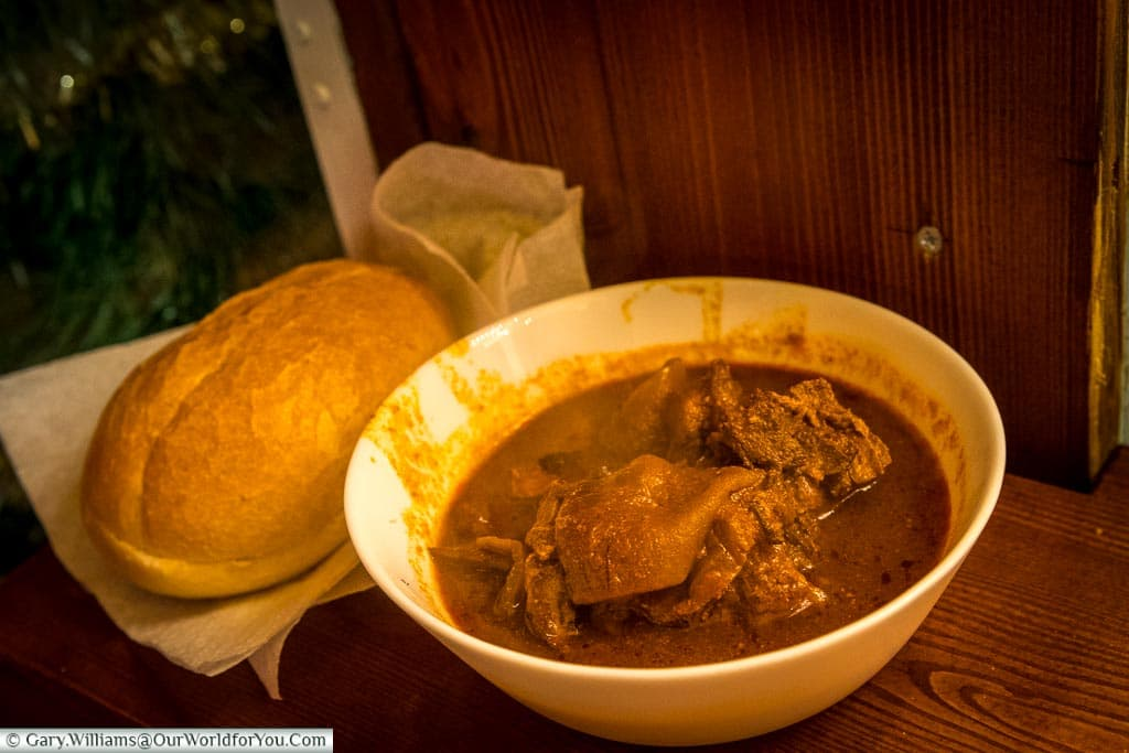 A bowl of steaming goulash soup and a crusty bread roll from Frankfurt's Christmas markets