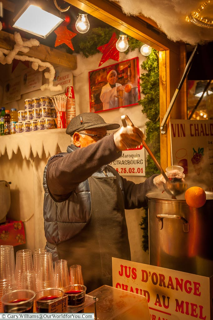Pouring the warming nectar at the Christmas market, Strasbourg, France