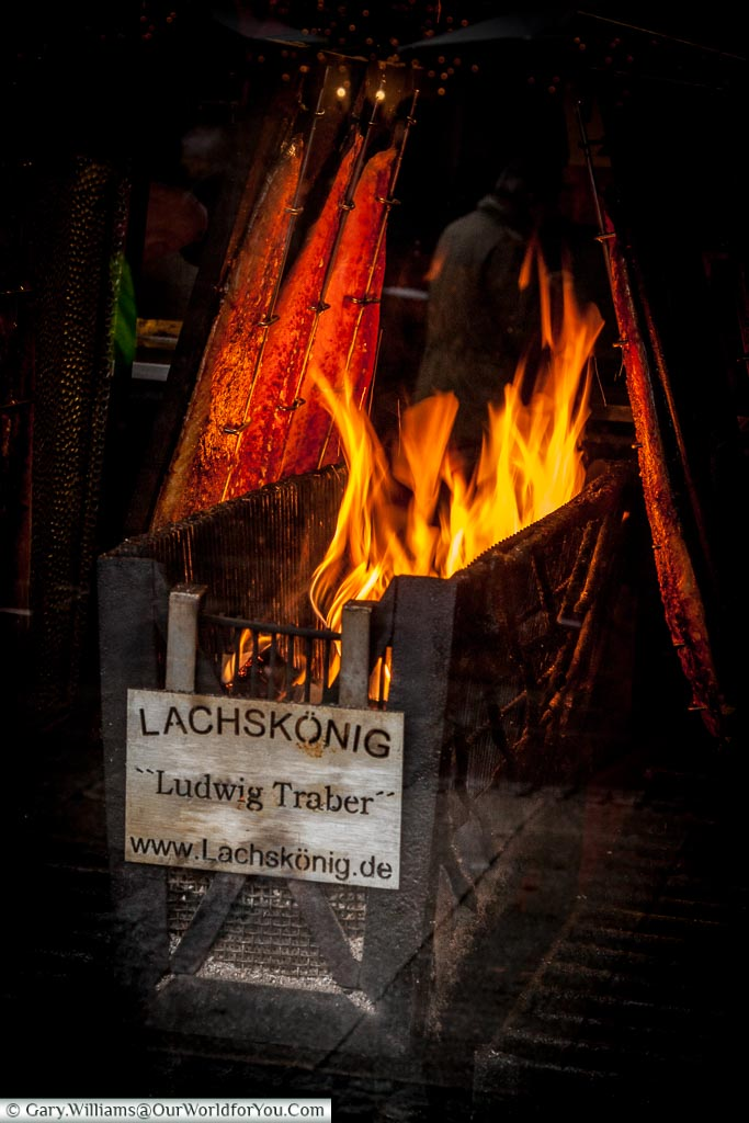 Salmon cooked the traditional way at the Christmas Markets, Cologne, Germany