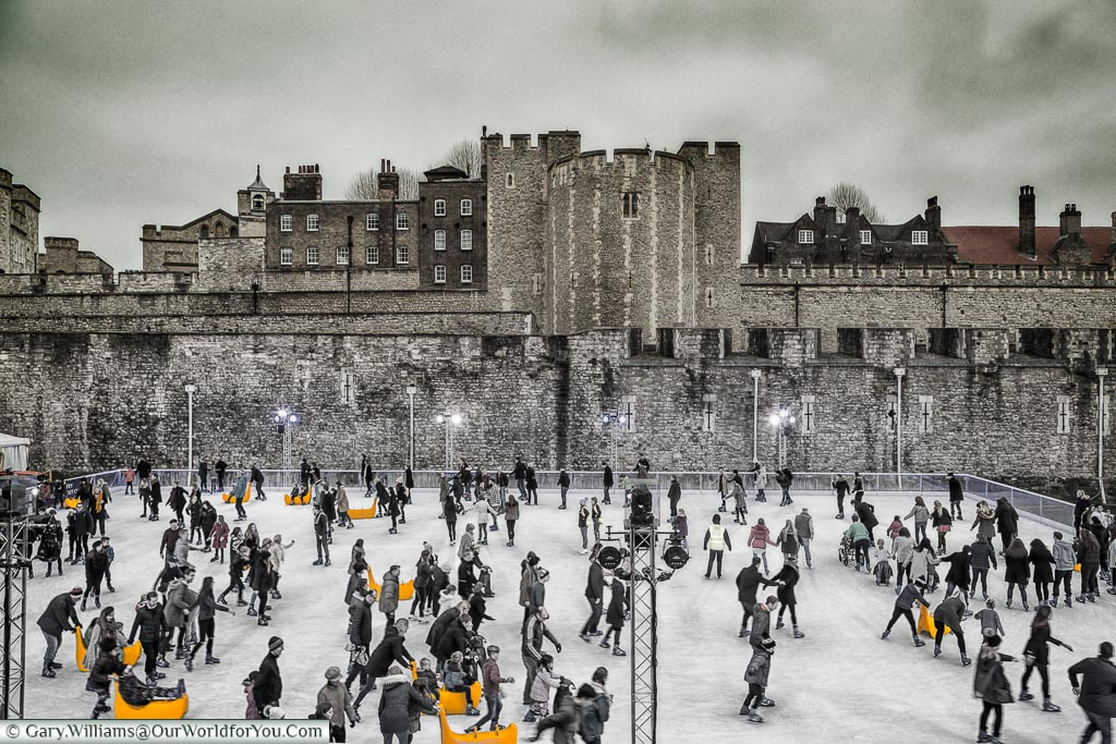 Skating on ice in front of the Tower of London, London at Christmas, UK