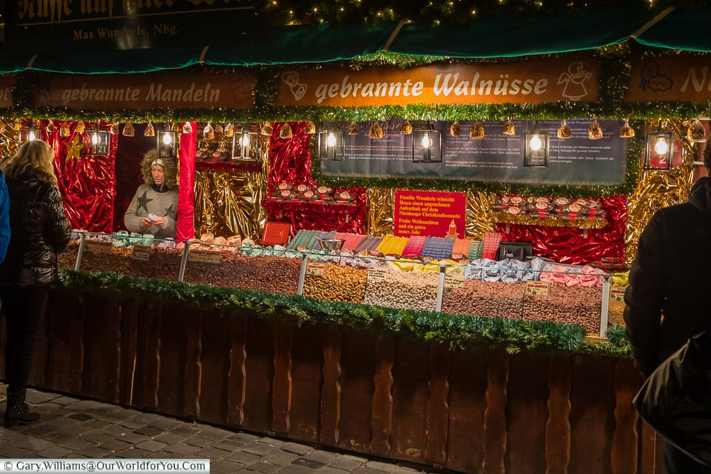 A nut seller offering sweet sticky nuts on a German Christmas Market stall in Nuremberg
