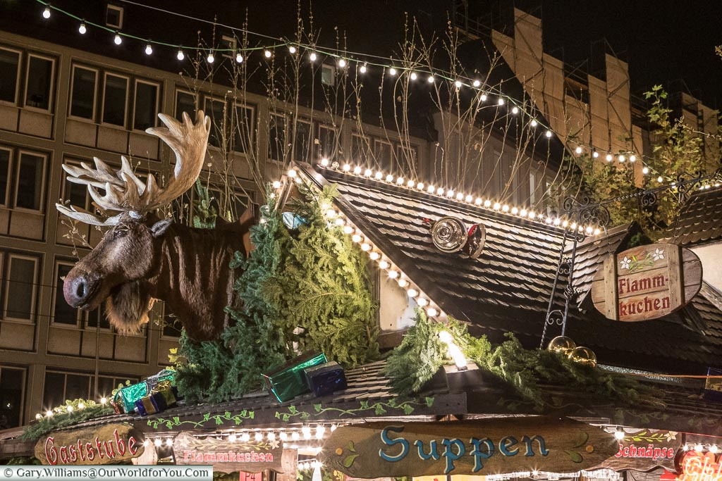 The top of a food stall on one of the Christmas markets with an animated Moose head that performs by singing classic Christmas songs like you've never heard before.
