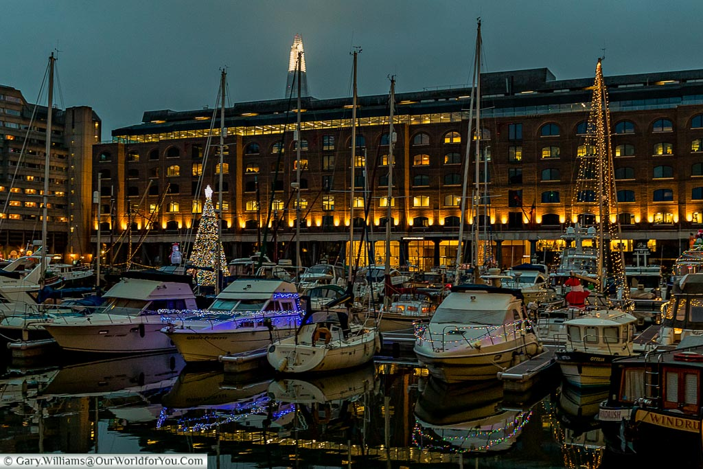 The twinkling marina at St Katherine's dock, London at Christmas, UK