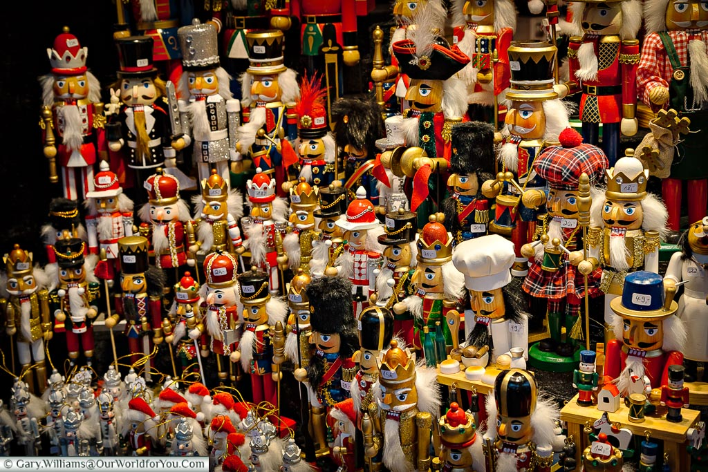 The close of a display of traditional nutcrackers. A mix of Kings, toy soldiers and artisans on a stall in Cologne's Chrismas market.