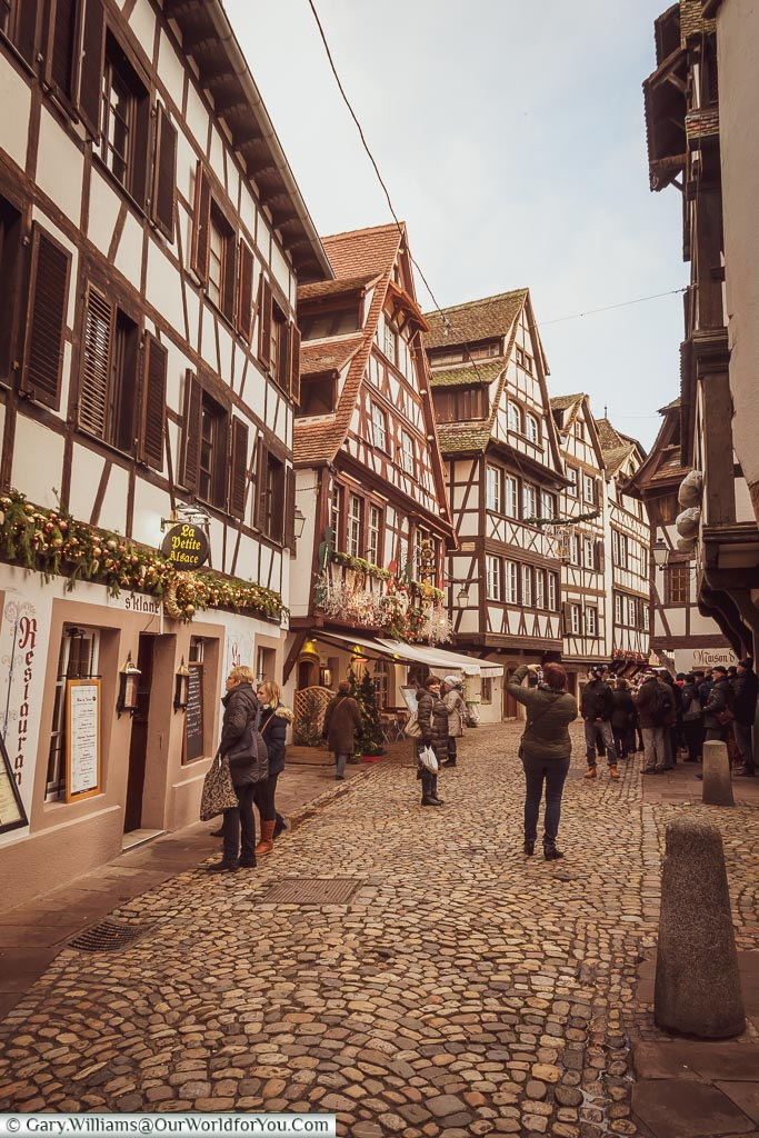 The cobbled lanes of Petite France between the half-timber buildings of this historic quarter of Strasbourg.
