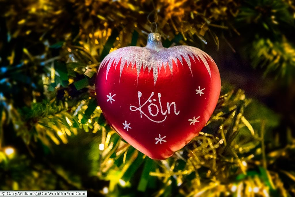 Our Cologne Christmas bauble; bright red with a glitter iced topping.  Koln is written the traditional German way.