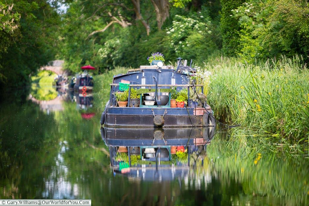 A blue boat on Kennet & Avon Canal, England, United Kingdom