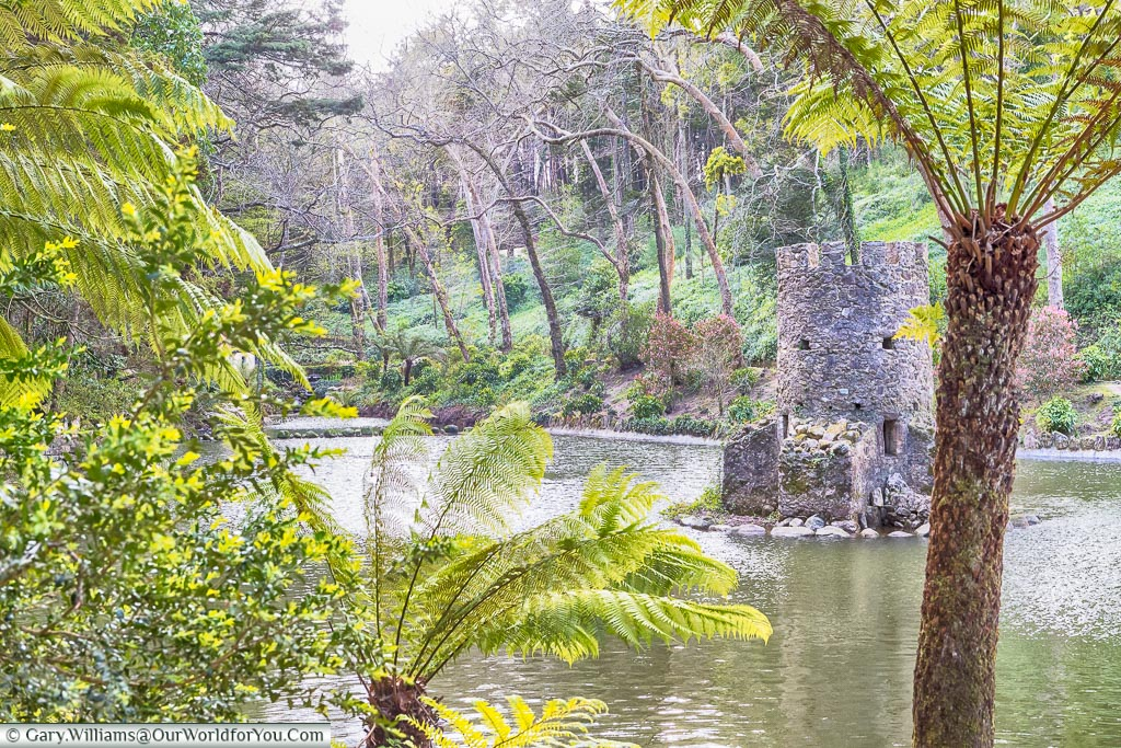 Looking back over the valley of the lakes at the other duck house in the gardens of the Palace of Pena, Sintra, Portugal