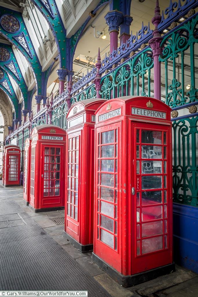 Red telephone boxes in Smithfield Market, Smithfield, London, England, UK