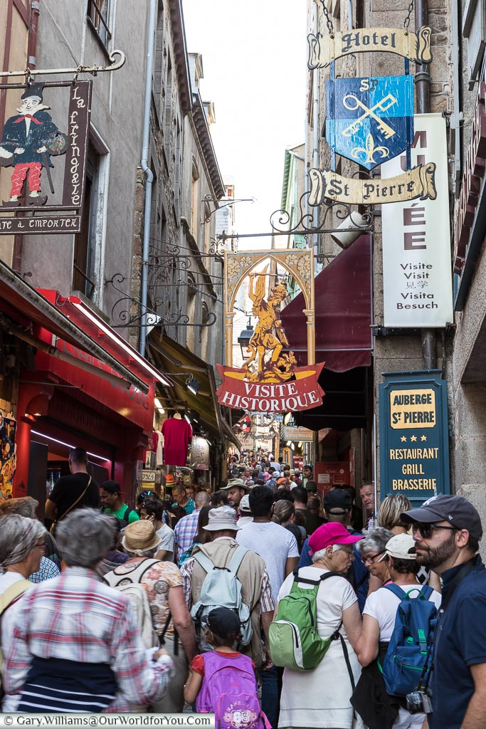 Joining the masses as we hike up the very busy Grand Rue of Mont-Saint-Michel.