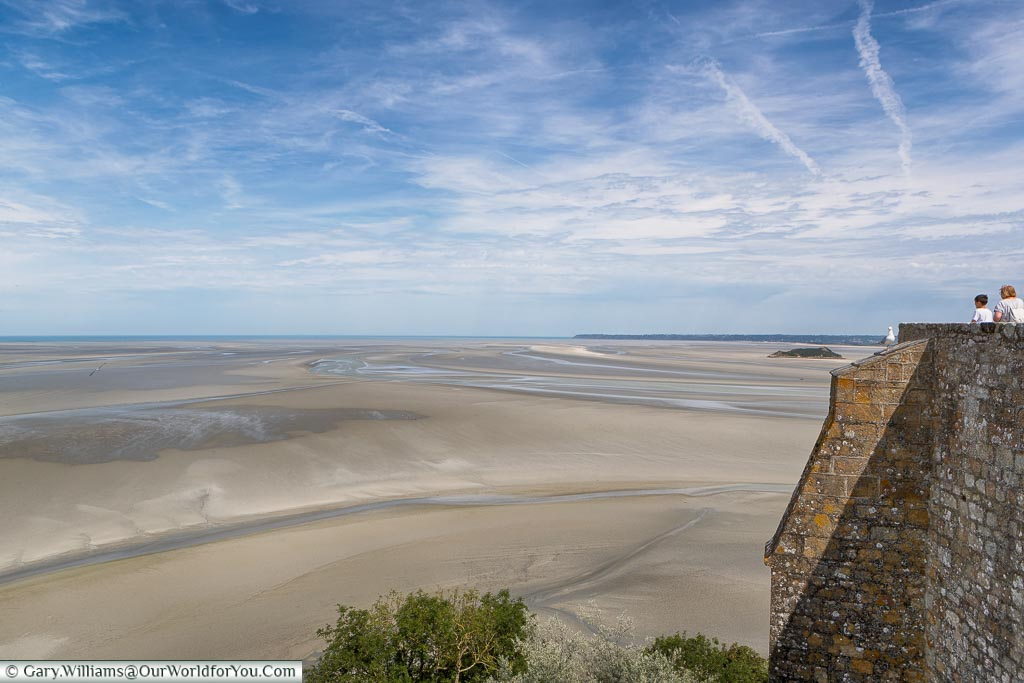 The view of the sand that surrounds Mont-Saint-Michel when the tide is out.