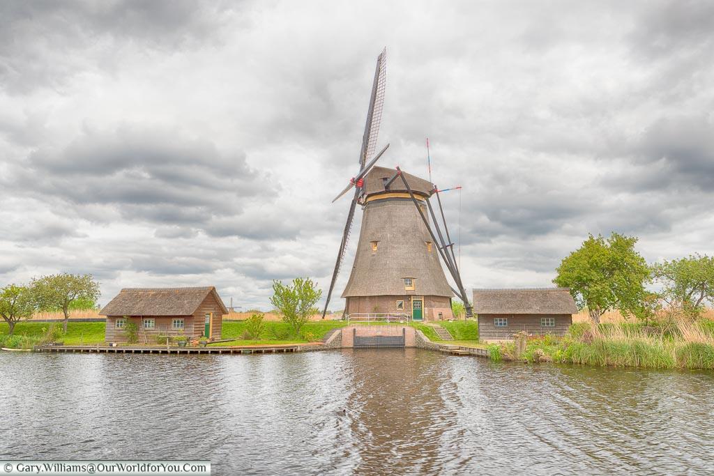 An octagonal, thatched, windmill, Kinderdijk, Holland, Netherlands