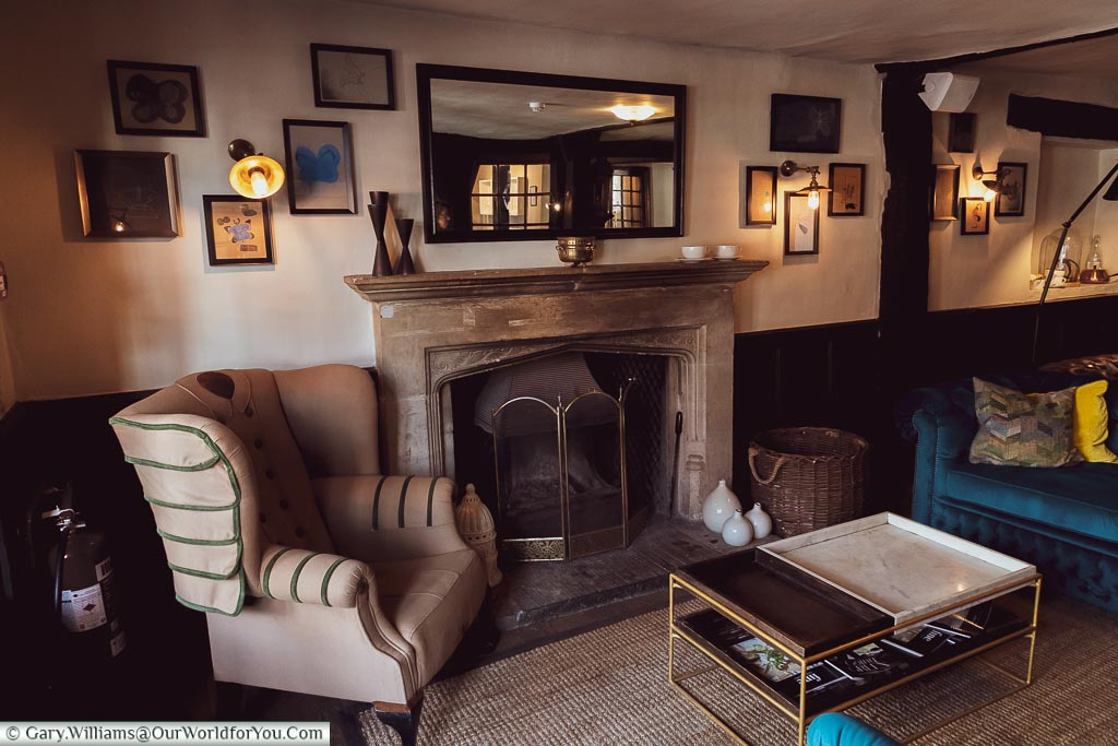 Around the fireplace in the lounge, The White Horse, bespoke hotels, Dorking, Surrey, England, UK