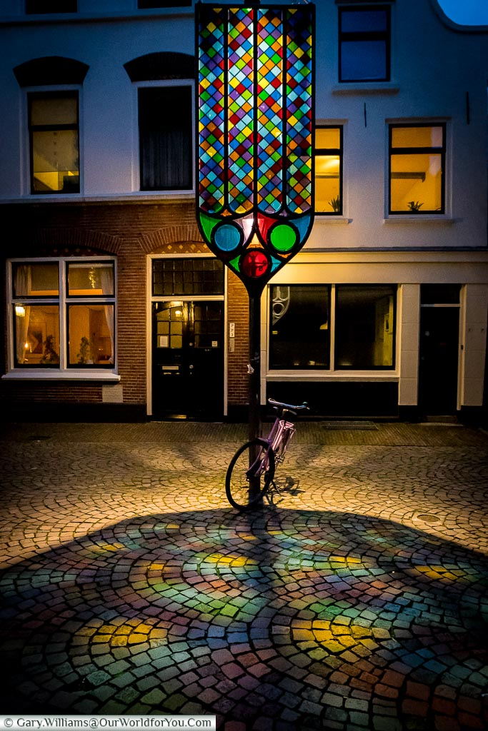 The colourful display of lights, reflected from a stand-alone stained glass window, as part of the Trajectum Lumen light installation in Utrecht