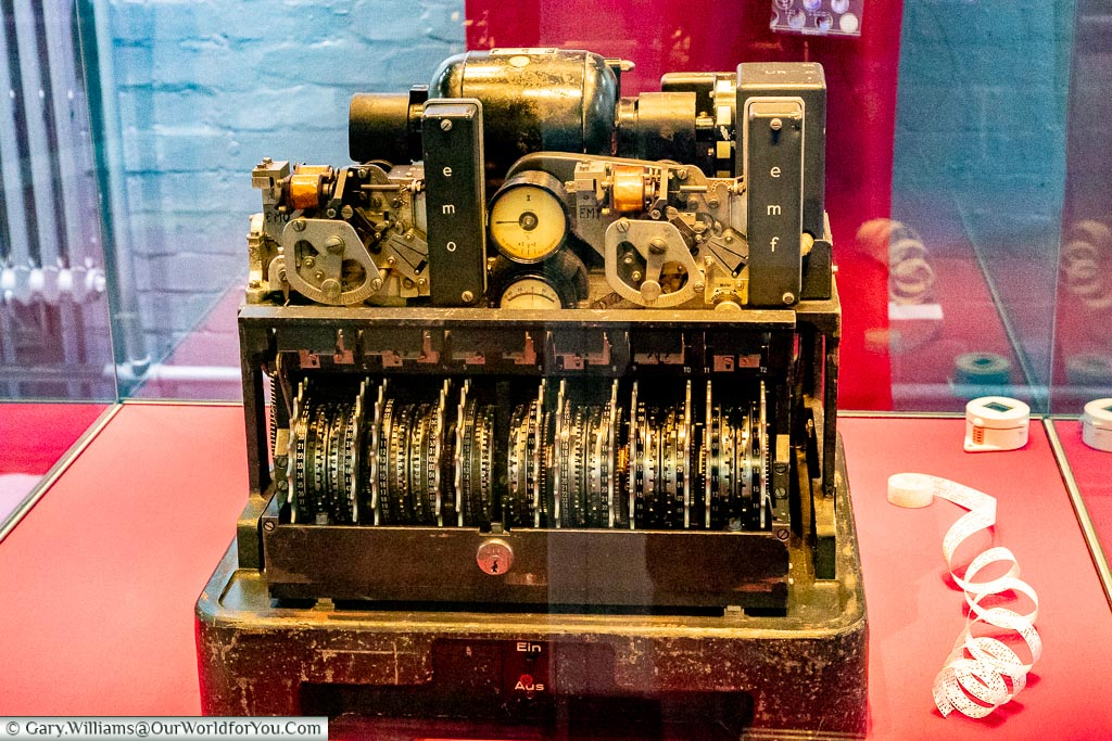 A captured cypher machine with its out case take off in a display cabinet at Bletchley Park
