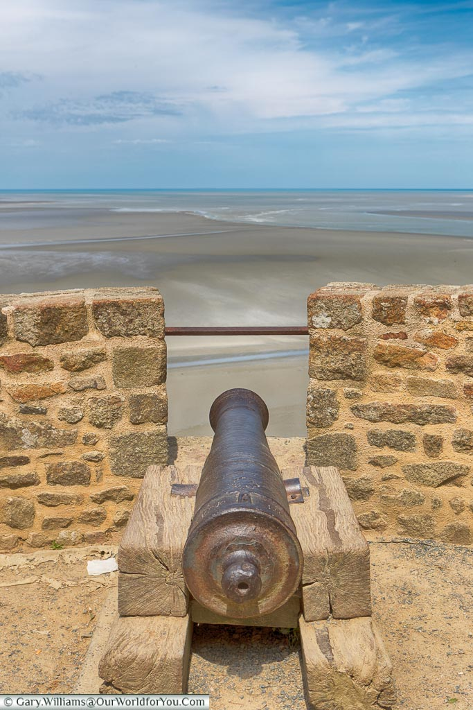 A cast-iron cannon, mounted on a wooden block, as a defensive measure to protect Mont-Saint-Michel