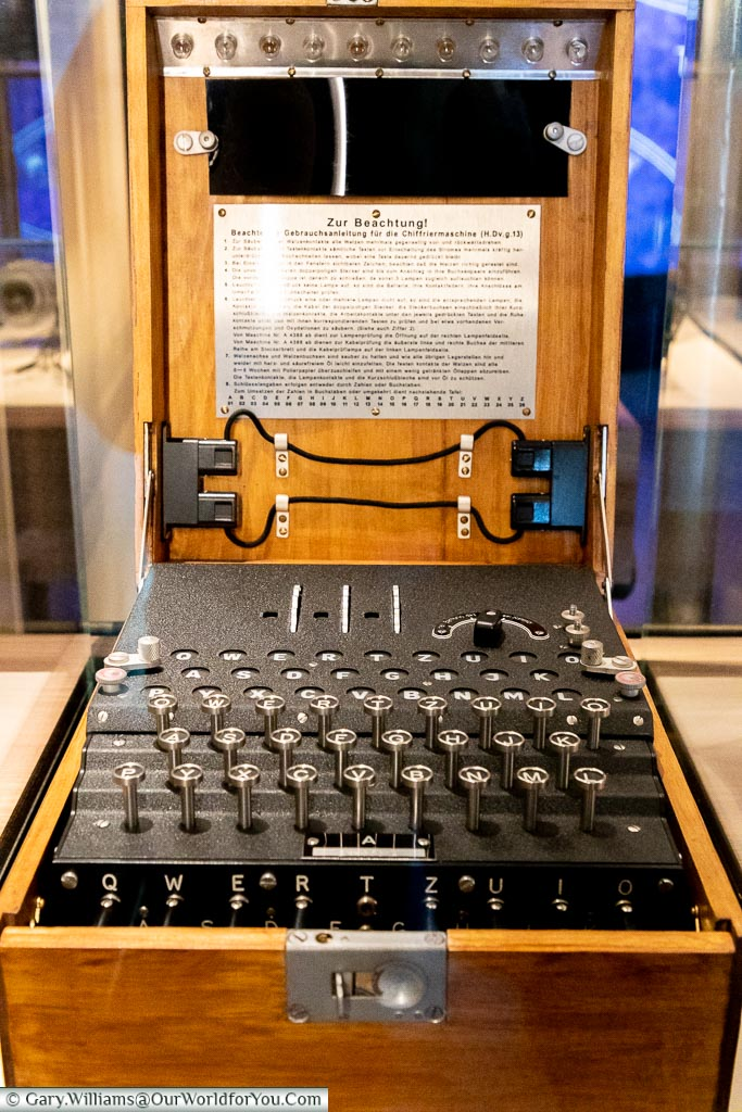 A boxed original Enigma 1 cypher machine in a display cabinet at Bletchley Park