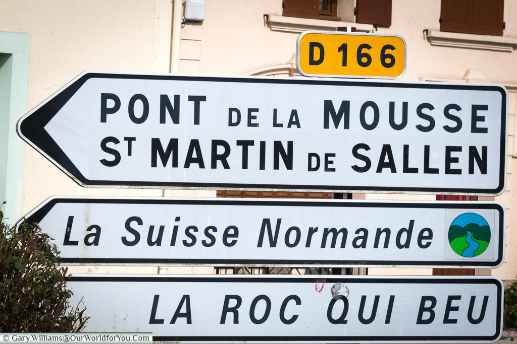 A road sign on the D166 through Normandy indicating you are following the route 'La Suisse Normande'