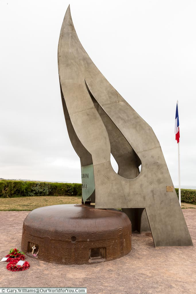 """An image of the memorial """"La Flamme""""; a large metal flame housed on top of a German bunker."""