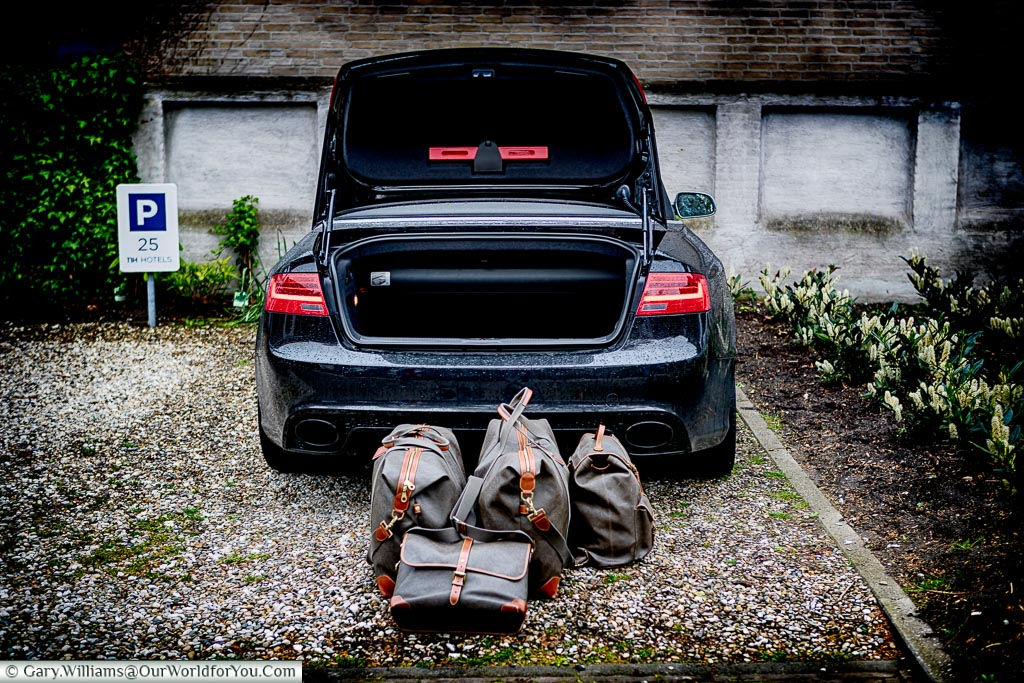 Our luggage stacked in front of the opened boot of our Audi parked in our Utrecht Hotel cark park