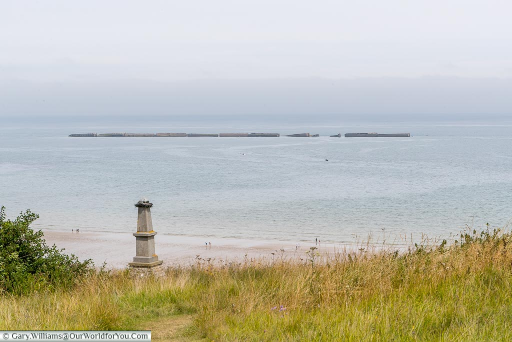 The remains of the Mulberry Harbour, constructed for the Normandy D-Day landings, out at sea.