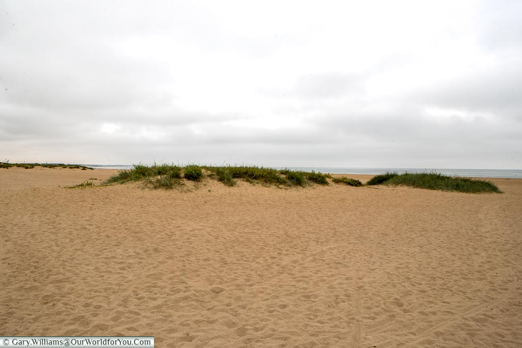 A grassy mound on the sandy beach, codenamed Sword during the D-Day Landing, in Normandy.