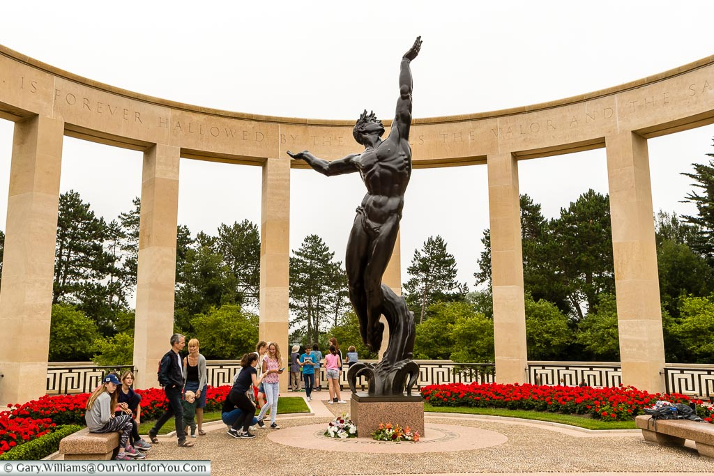 The 'Spirit of American Youth Rising from the Waves' statue in the centre of the memorial garden at the Normandy American Cemetery.
