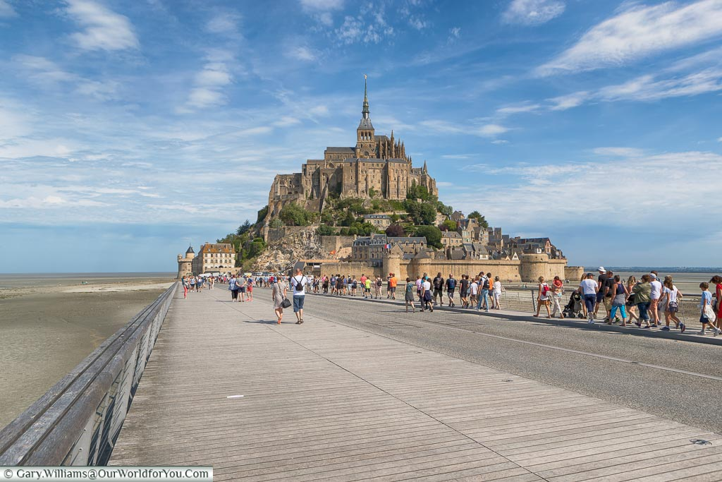 A shot of the wide, paved, causeway to the island of Mont-Saint-Michel , Normandy