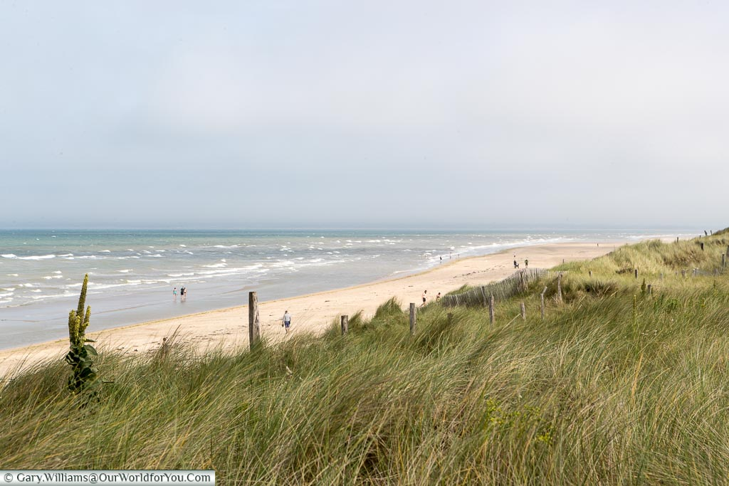 The sandy shoreline of Utah beach on a blustery day.