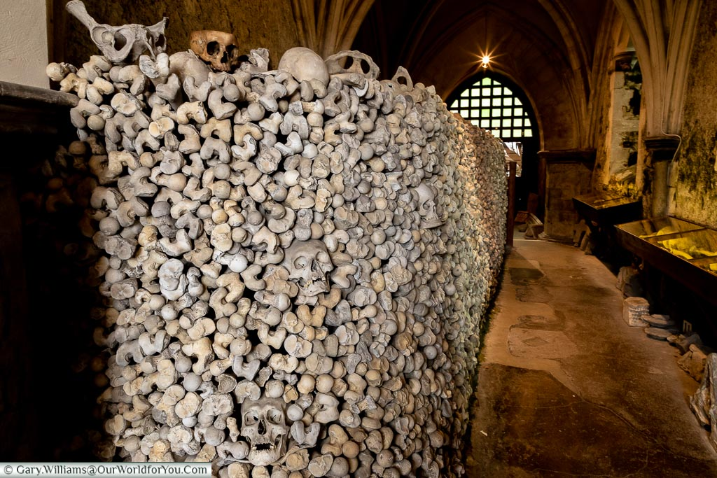 A wall of bones in the Ossuary of St Leonard's Church in Hythe