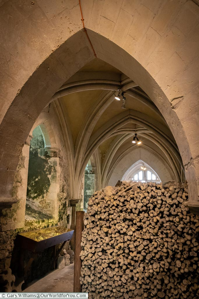 Bones stacked up under the vaulted roof of the Ossuary of St Leonard's Church in Hythe