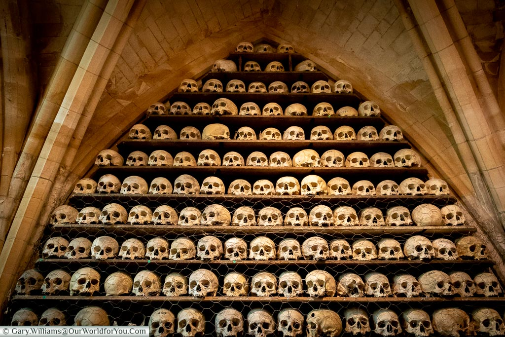 A stack of skulls held in the Ossuary of St Leonard's Church in Hythe