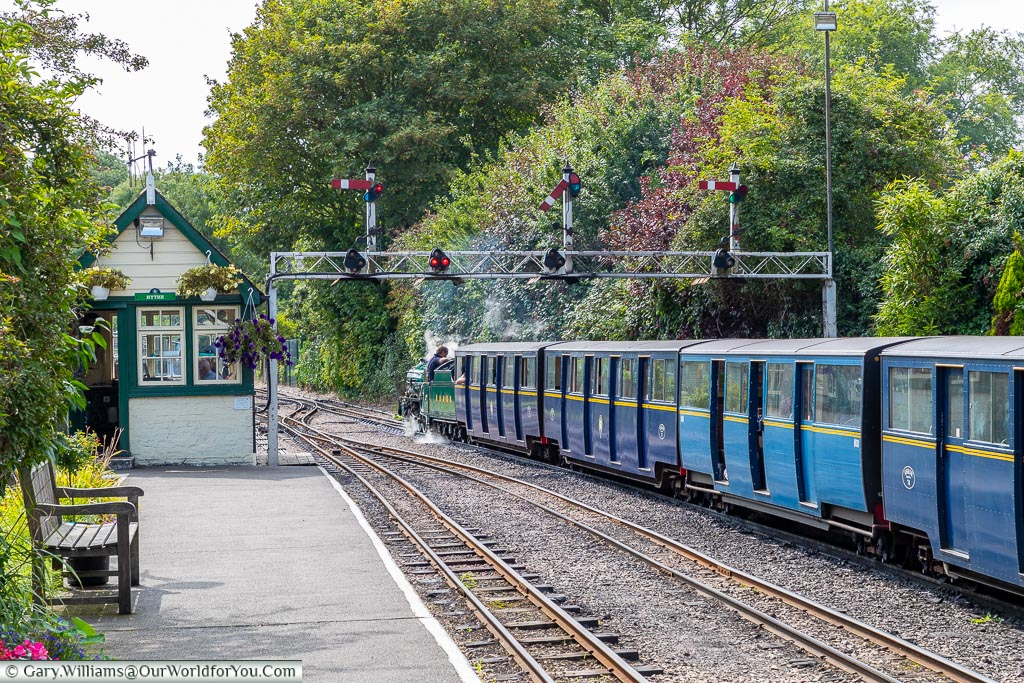 A steam train from the Romney, Hythe and Dymchurch Railway departing Hythe station