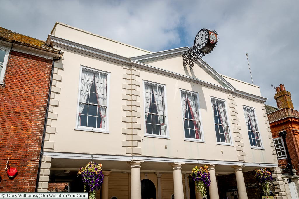 Hythe's 18th-century town hall with its clock on brackets projecting from the building