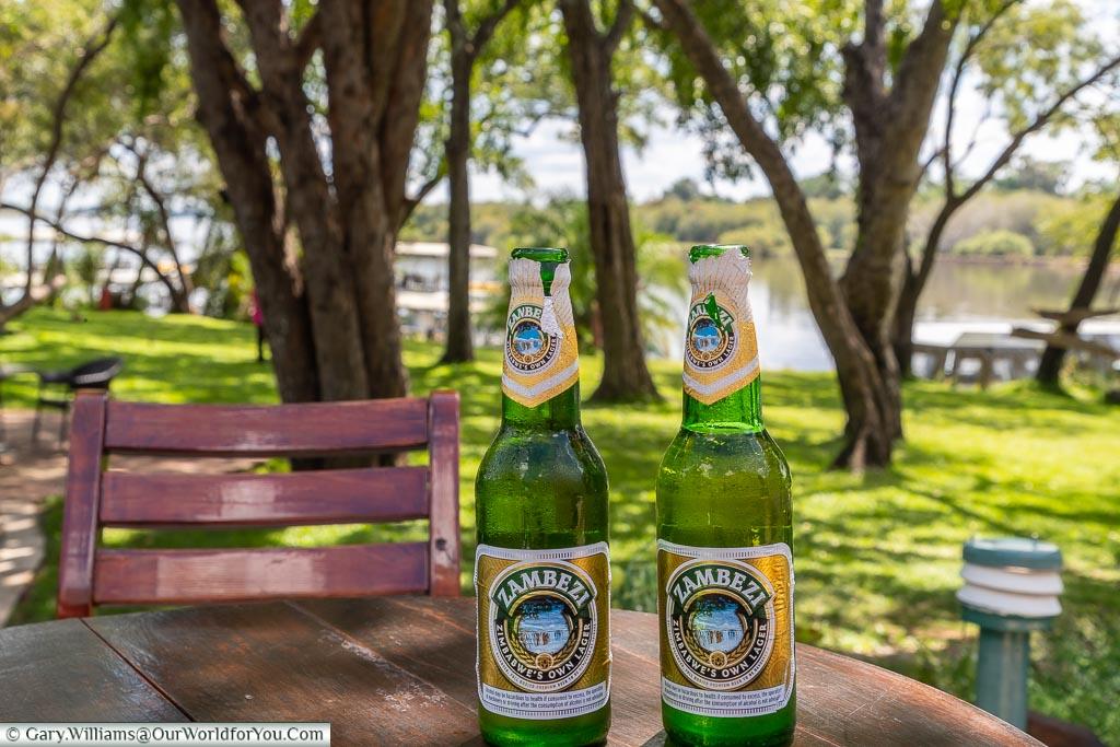 A couple of Zambezi beersat theA'Zambezi River Lodge, Victoria Falls Town, Zimbabwe
