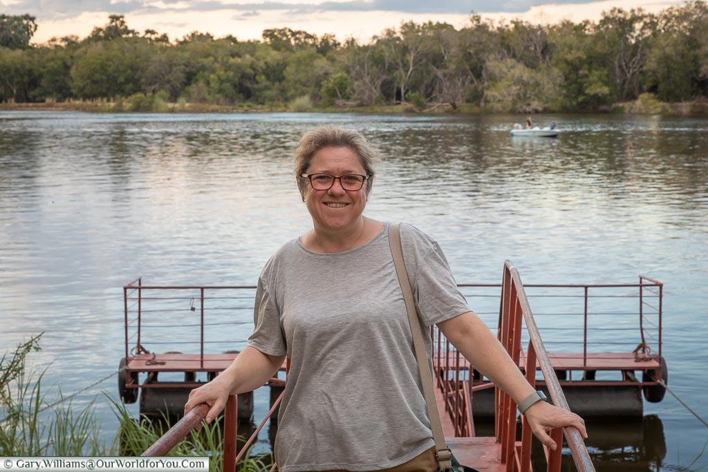 Janis at the edge of Zambezi at the A'Zambezi River Lodge , Victoria Falls Town, Zimbabwe