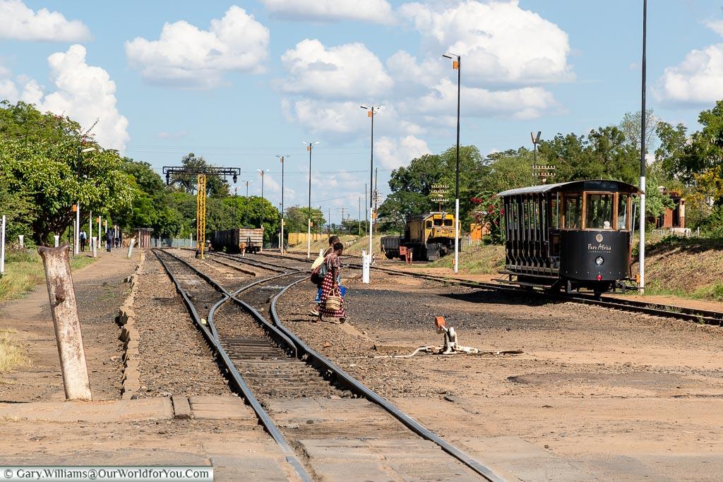 Ladies crossing the tacks at Victoria Falls railway station, Victoria Falls Town, Zimbabwe