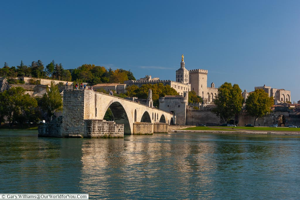 The view of Pont d'Avignon, from across the river Rhône, with the Palais des Papes in the background