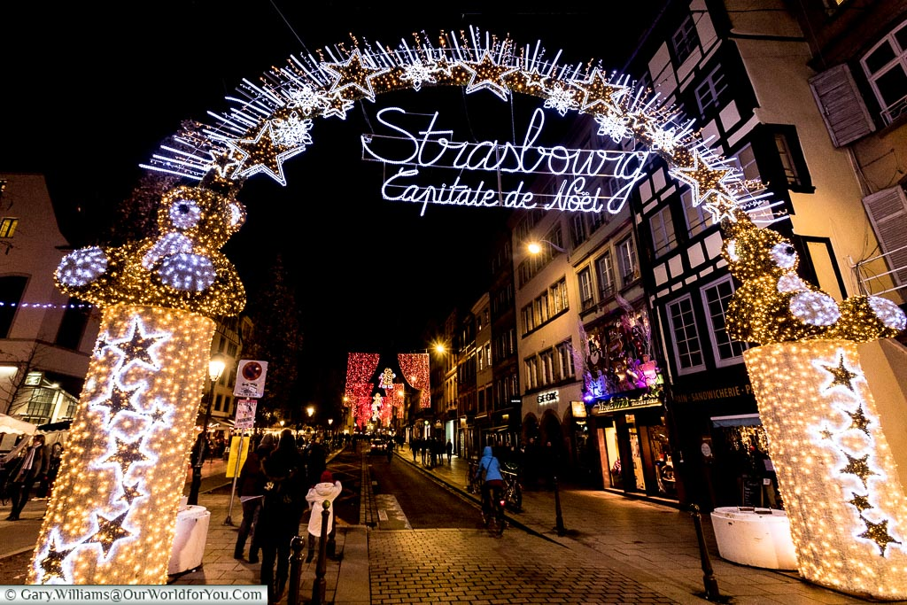 The bright illuminated arch over the Rue du Vieux-Marché-aux-Poissons that declares Strasbourg as the Capitale de Noel, or Capital of Christmas.