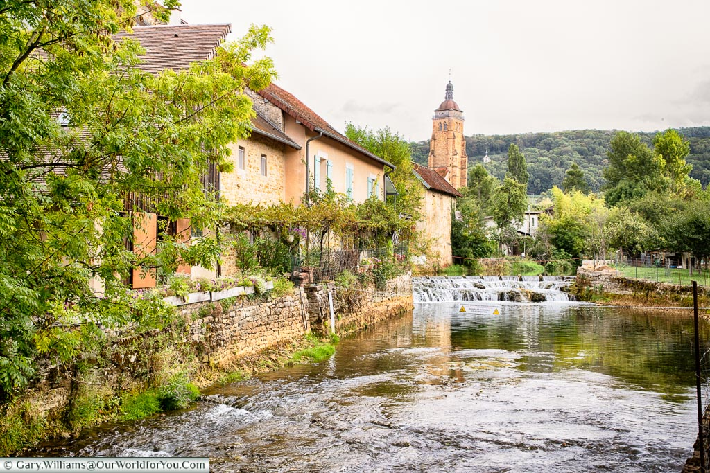 The Cuisance River flowing through Arbois, France