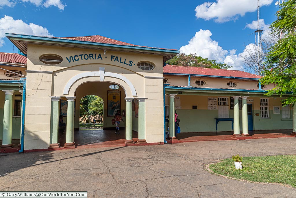The entrance arch to the colonial Victoria Falls station with its soft greens & creams.
