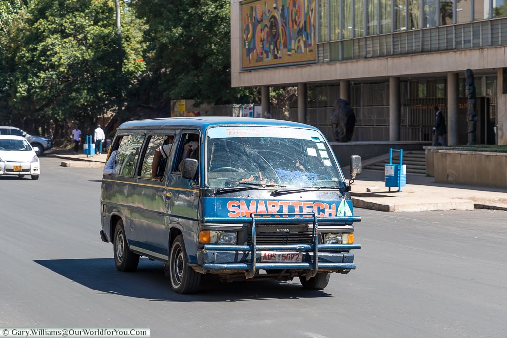 A well used Nissan minibus serving as a commuter bus in central Harare.
