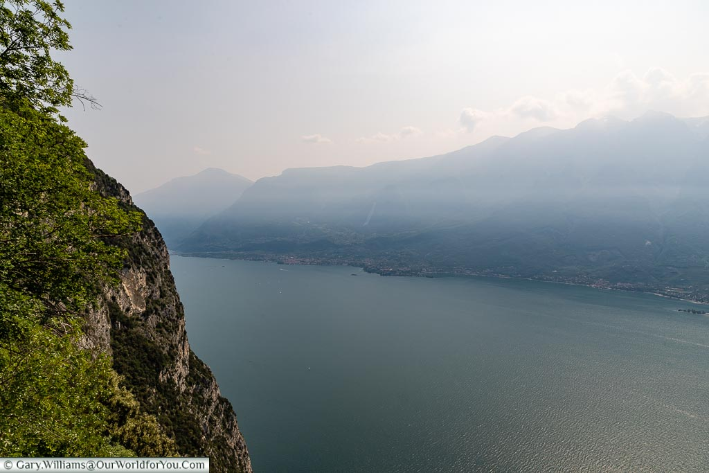 A view from up high, outside Sanctuary of Montecastello, across a hazy Lake Garda.