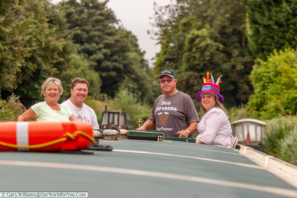 Janis, and her family, around theow end of a canal boat.
