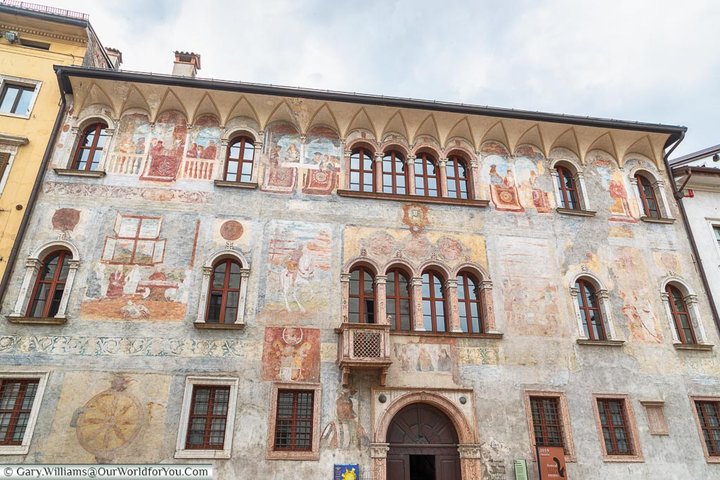 The front of Palazzo Geremia which is covered with faded frescos from top to bottom of the exterior.