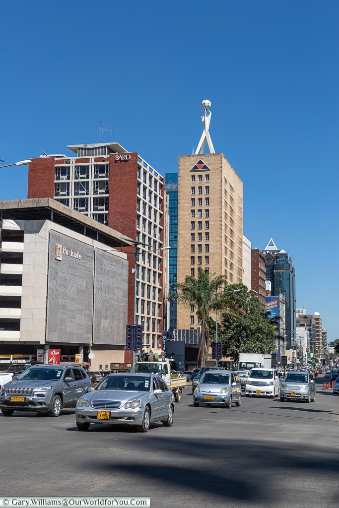 A street view of central Harare focussing on the Pearl Assurance House tower block.