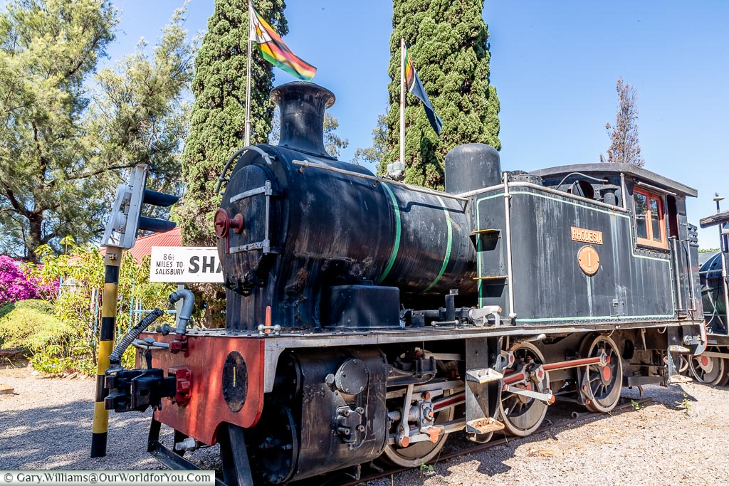 A small steam locomotive, a little weathered, called the Rhodesia.
