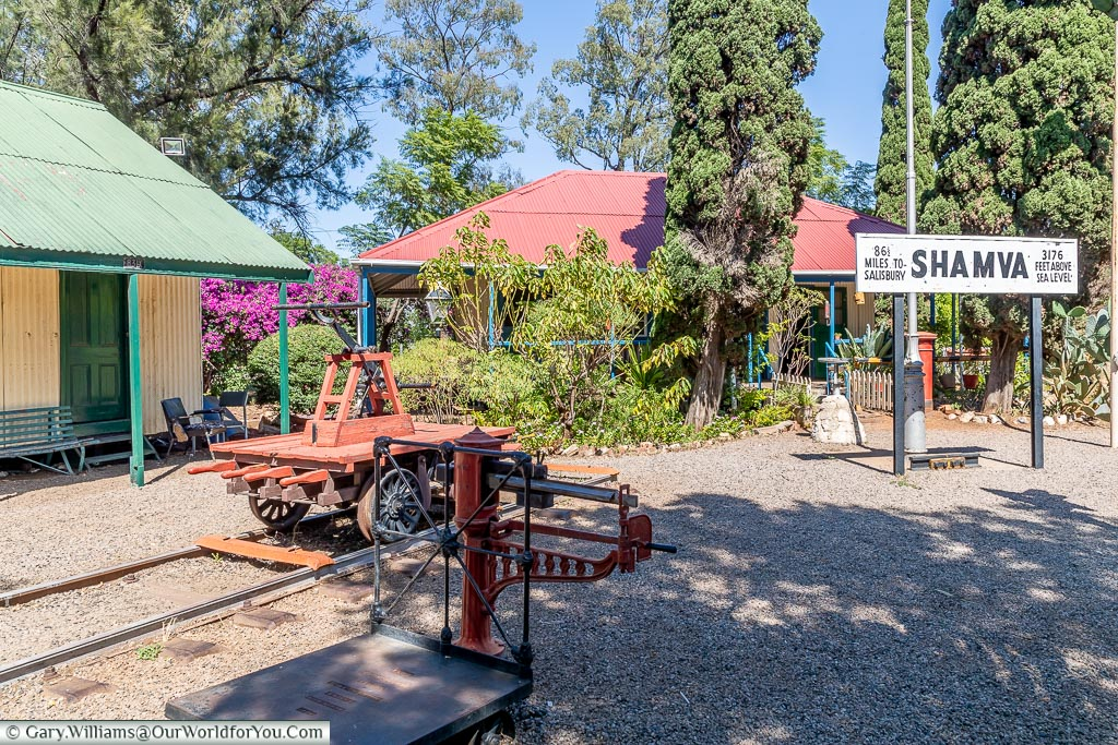 The ticket office of the National Railways of Zimbabwe Museum with various bits of railway paraphernalia strewn around.